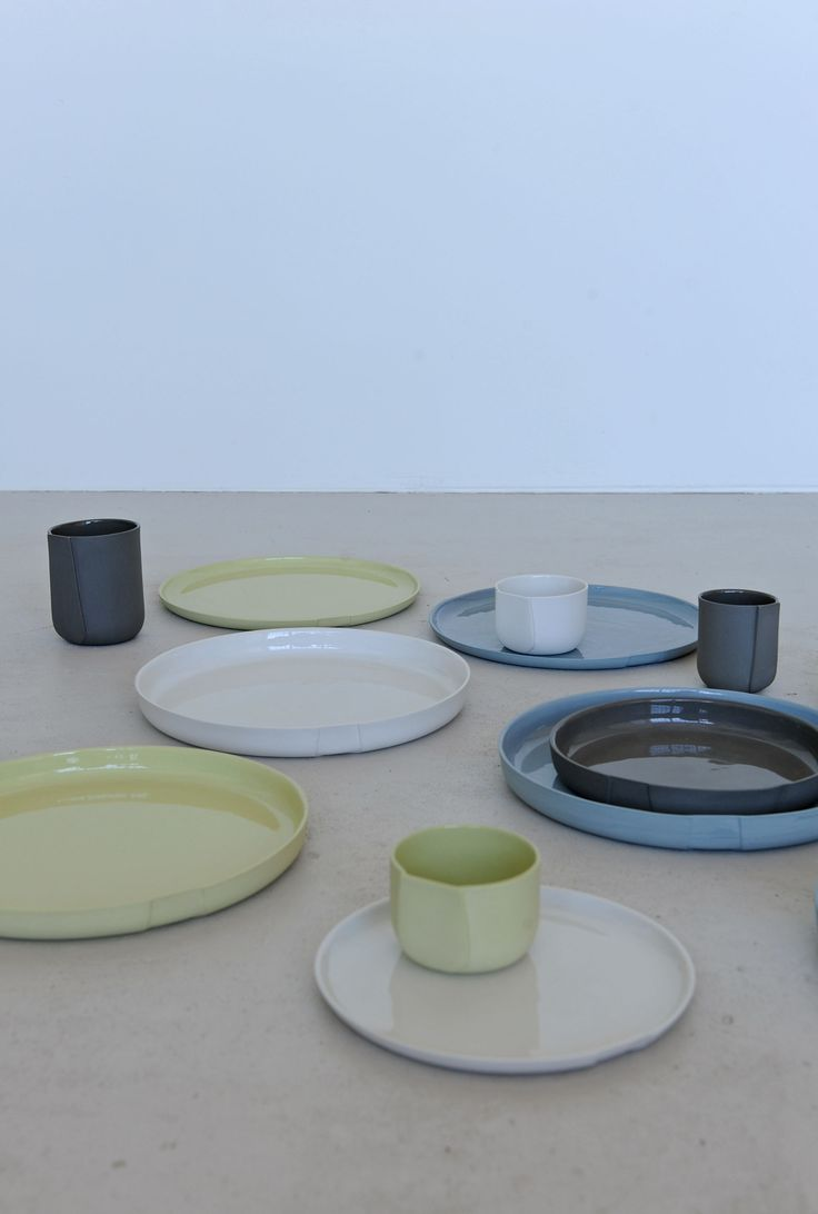 Table Talks - The porcelain tableware collection 'Table Talks' has a characteristic flat part, which funtions like a label. Logo's can be stamped in the clay or little messages can be written on. This to creat a personal cup. The collection contains plates and cups in a wide range of sizes.  www.lottedouwes.nl