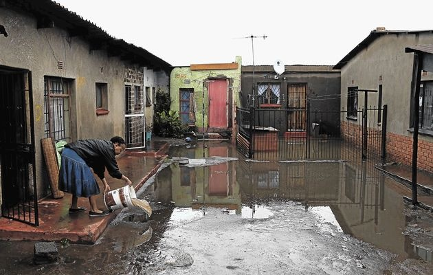 Soweto, ECape Floods | A homeowner in Kliptown cleans her house after the area was flooded by heavy rains on Friday and Saturday | Photo James Oatway / www.timeslive.co.za