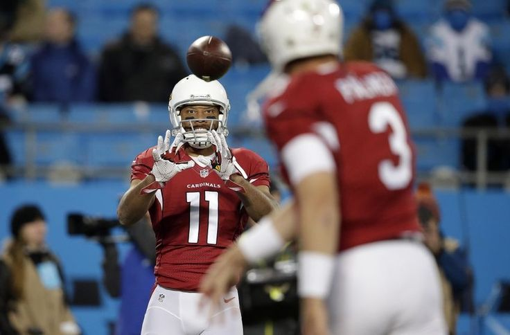 Jan 24, 2016; Charlotte, NC, USA; Arizona Cardinals wide receiver Larry Fitzgerald (11) and quarterback Carson Palmer (3) warm up before the game against the Carolina Panthers in the NFC Championship football game at Bank of America Stadium. Mandatory Credit: Jeremy Brevard-USA TODAY Sports