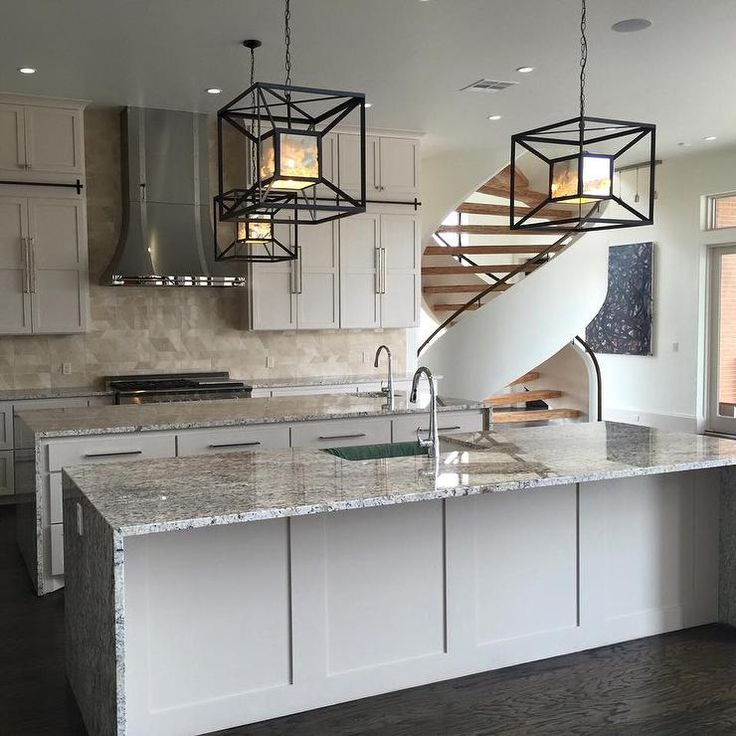 High ceilings large geometric pendants counter to