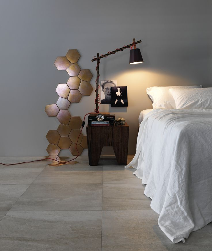 The Portobello Tresor Argent tiles make a feature wall in this stylish bedroom
