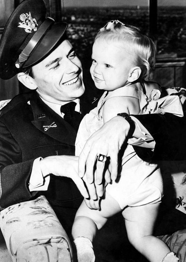 Ronald Reagan at home with his daughter Maureen Reagan, 1943