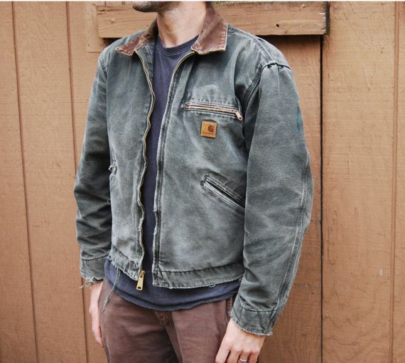 Okay, so this is going to date myself, but my boyfriend back in 1990 used to wear a Carhartt jacket, a tan one, and my how he looked SO good in it. Fast forward to 2014 and my husband looks pretty hot in one too! This Detroit jacket, like a handful of other distressed jackets in my shop, has been worn and loved. Structurally intact and still quite sound, it has a great deal of nice surface wear throughout. Worn previously by someone who must have frequently worked on cars (I found a 70s era…