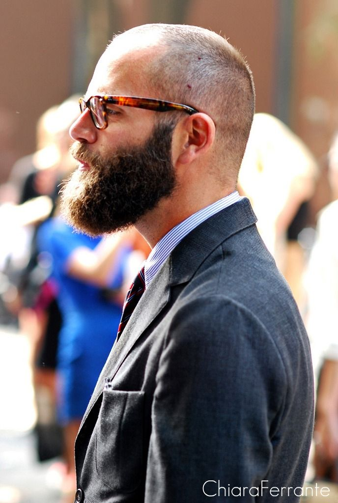 Brown long bearded man with styled glasses