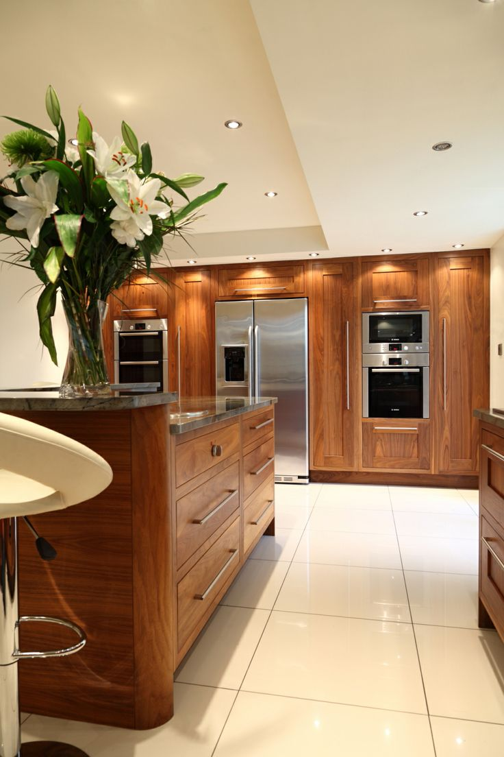 Wall to wall and floor to ceiling black American walnut with 30mm Fashion Blue Granite worktops