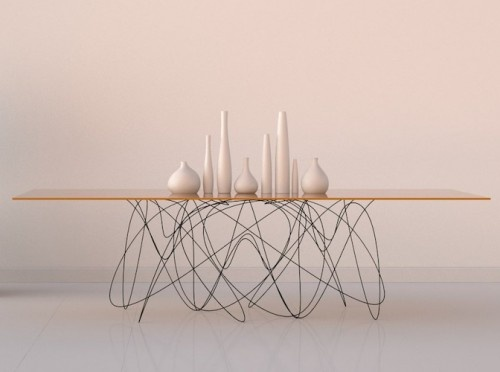 Oh I would die for a table like this. The base aims to visualize the path of subatomic particles, obviously.