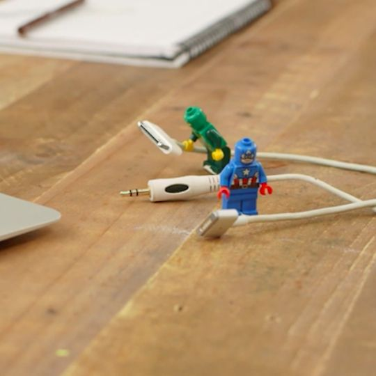 Frustrated by loose and tangled cables for your electronics? Let a LEGO lend a hand and be an organizing superhero.