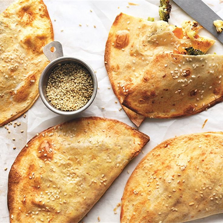 Need a snack on the go? Try Donna Hay's easy hand pie recipe, made using scrumptious flour tortillas with a delicious vegetable filling.