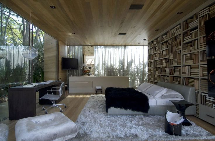 bedroom:Amazing Design Bookshelf In Bedroom With White Wooden Wallpaper Bookcase Mounted On The Wall And Comfy Gray Leather Double Beds Using Black Fur Blankets On The Beds Also Dark Brown Wooden Rectangle De Comfy Sleep With Modern Bedroom Design
