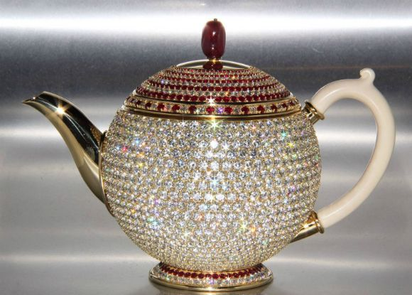 Impossible to ignore, the gold is embedded with 1658 brilliant diamonds and 386 authentic Thai and Burmese rubies; adding a crimson punch to the pot's exterior.    The teapot forms is owned by the N Sethia Foundation, a philanthropic organization that provides education, spiritual activities, and medical research in London.     The designer of the glittering treasure was the charity's founder and Chairman of Newby Teas