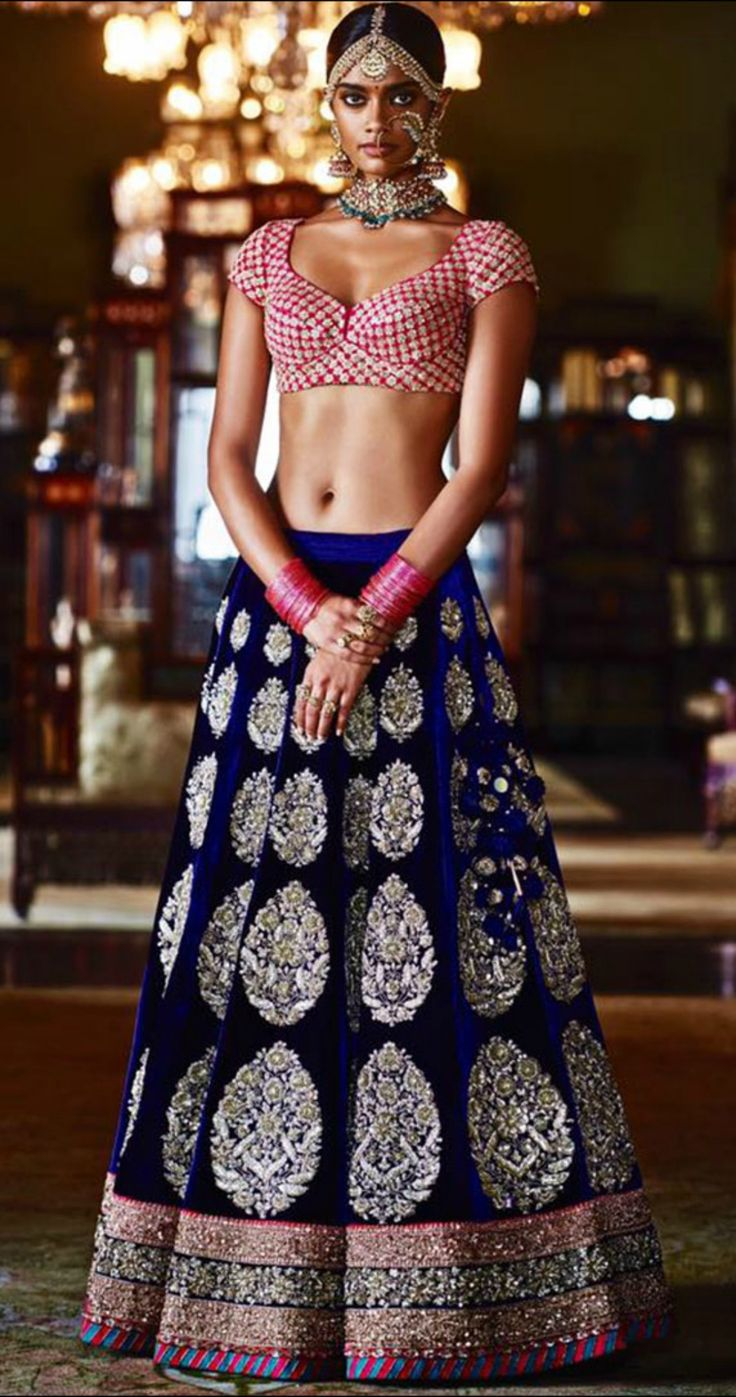 Sabyasachi weaves magic when it comes to Indian wear, be it sarees or lehengas. This velvet blue lehenga from his heritage collection is simply breathtaking. It evokes both grandeur and innocence, the best complement of looks to aim for, if you are a bride.