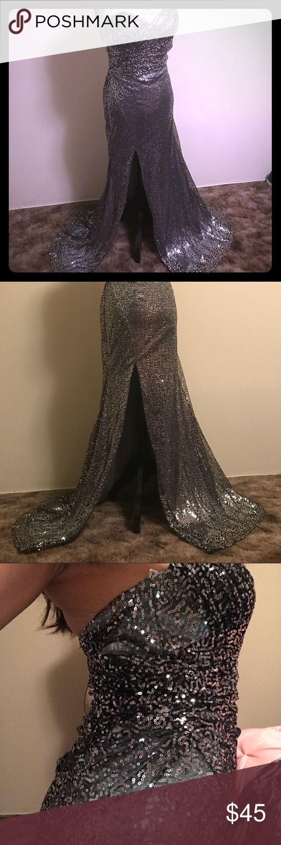 Long silver sequence dress Embrace the night with this bare shoulders, glamorous and sequenced dress, it's long and has a slit on the right.  ASPEED, size small, $45 (that will turn heads!) Aspeed Dresses Strapless