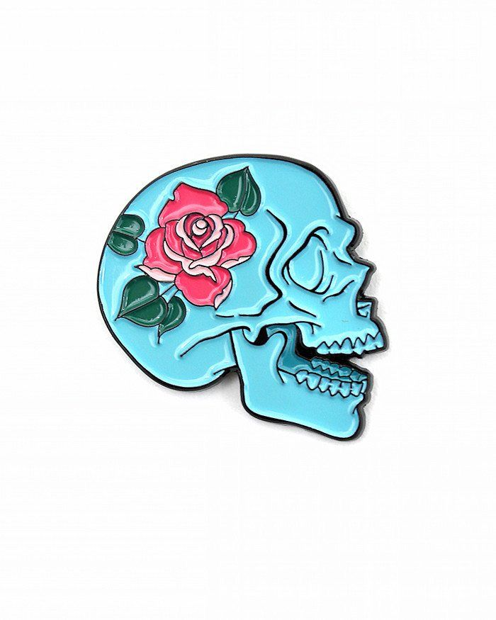 Bright color tones make this illustrated skull design more beautiful than it is dark. Exclusive collaboration between Allison Bamcat and Strange Ways. - Soft enamel lapel pin - Rubber clutch pinback -