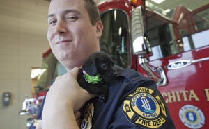 One of the firefighters who helped save a 10-day-old puppy from a house fire on Jan. 21, has agreed to adopt the puppy. Ember, a mixed-breed terrier, lost her mother and a sibling in the fire. Her previous owner didn't want to keep her.