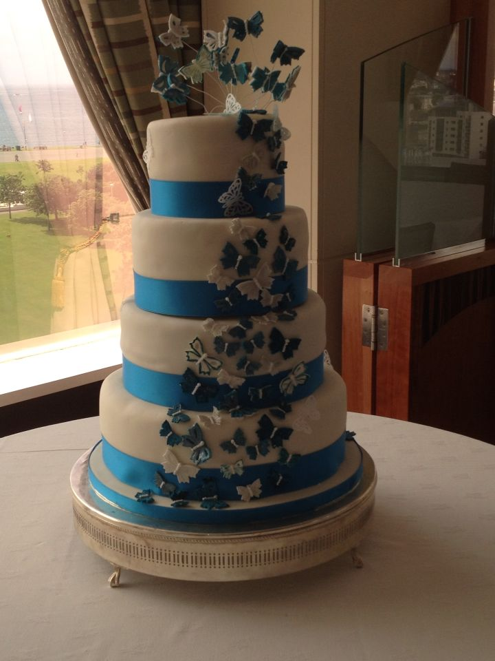 Beautiful spray of hand painted butterflies on this gorgeous 4 tier wedding cake
