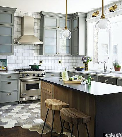 HGTV's Genevieve Gorder's favorite home decor and interior design picks for 2016 - on the Dog Lady Design Files blog! One of her favorites? Mixed metals.This kitchen is amazing - brass lighting, wood counter stool, graphic neutral tile and stainless steel appliances.  Interior Design, Home Decorating and Dog Musings from Jersey City www.dogladydesignfiles.com