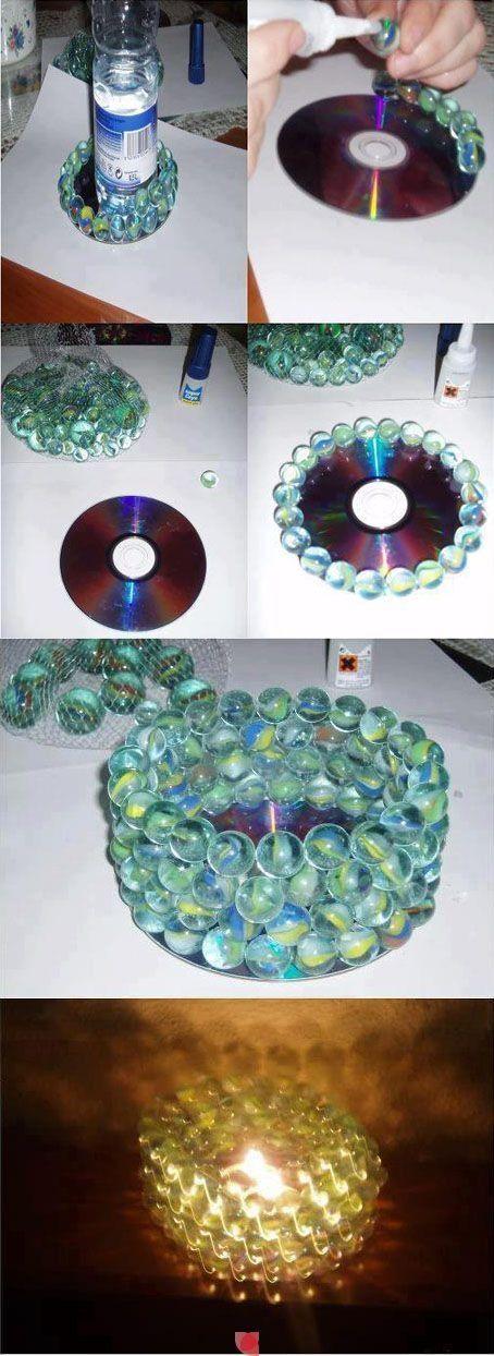 Oude cd met knikkers .... Leuke waxinelichthouder
