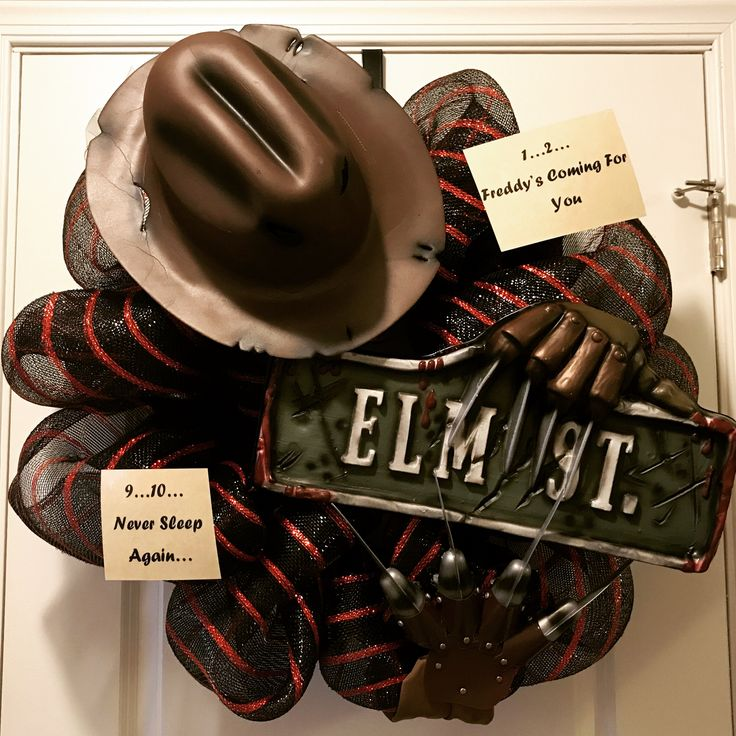 Hand made Freddy Krueger wreath. Hat, claws, and Elm street sign can be found on Amazon and the deco poly mesh was purchased on craft outlet.