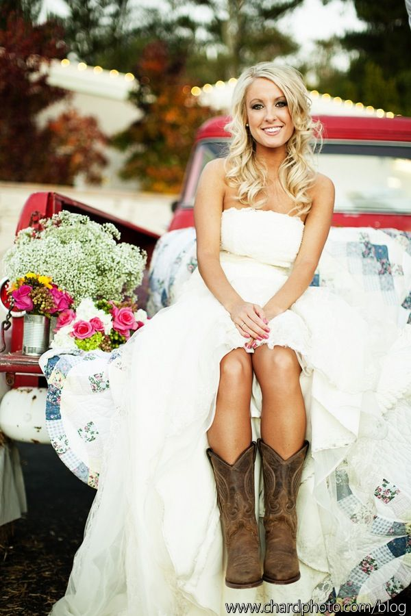 Love this country wedding with the pick up truck. All she needs is her cowgirl boots!