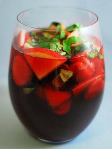 3 c. Woodbridge by Robert Mondavi Sweet Red Wine  1 c. strawberries, sliced  1 fuji apple, sliced  ½ c. basil bunch, stems attached  Raspberry seltzer water  Combine sliced strawberries, sliced fuji apple, basil bunch, and wine in a large pitcher. Place in refrigerator for 15 minutes. Add seltzer, stir, and top with basil to garnish.  -Cosmopolitan.com