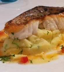 Grilled hake on spring onion mash with soy butter slider