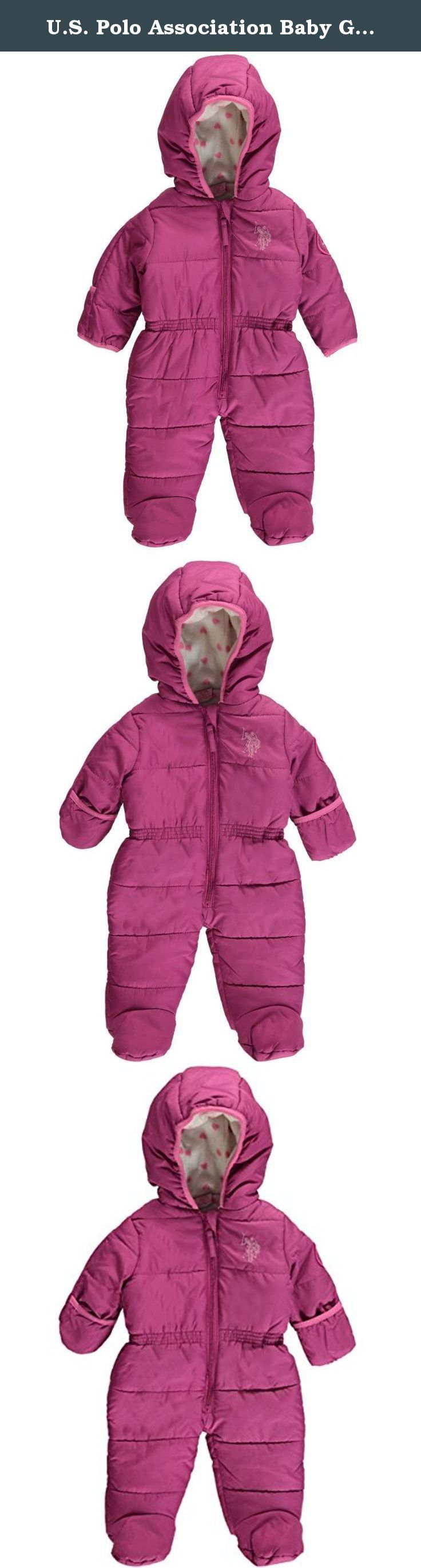 """U.S. Polo Association Baby Girls' """"Thick Ice"""" 1-Piece Snowsuit - Festival Pink, 6/9 Months. This U.S. Polo Assn. snowsuit comes with a weather-resistant exterior, fleece lining, and extra insulation for all-winter wear. Zipper down the front, foldover mitts, feeties. 100% Polyester Machine Wash Cold Imported."""