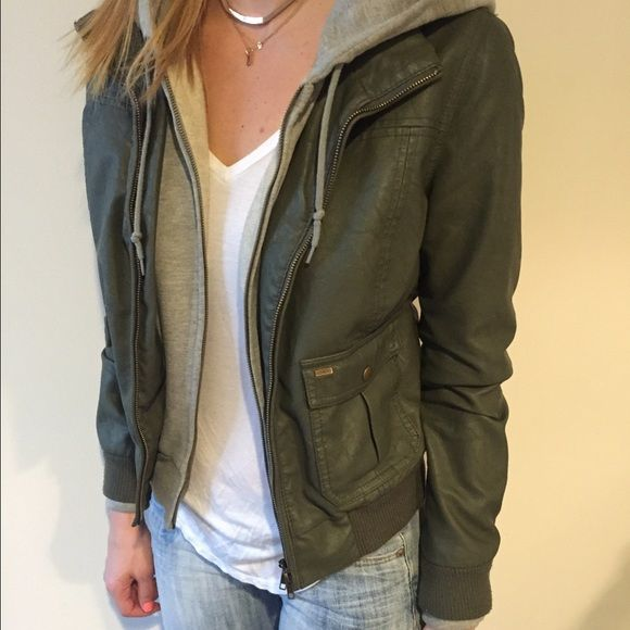 Obey vegan leather jacket with hood Olive in color. Brand is Obey. Super cute layered looked to it because of the sweatshirt that is built in. Real pockets in the front and both of the zippers work. Obey Jackets & Coats