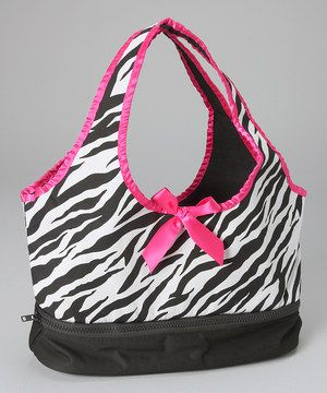 Now busy little gals have an easy way to store and transport their little friends. Equipped with a separate zipper compartment at the bottom, this roomy bag has room for other treasures too!