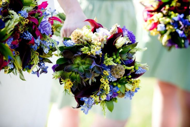 Bridesmaids' Bouquets: Delphinium, Gloriosa Lilies, Calla Lilies, and Hyacinth