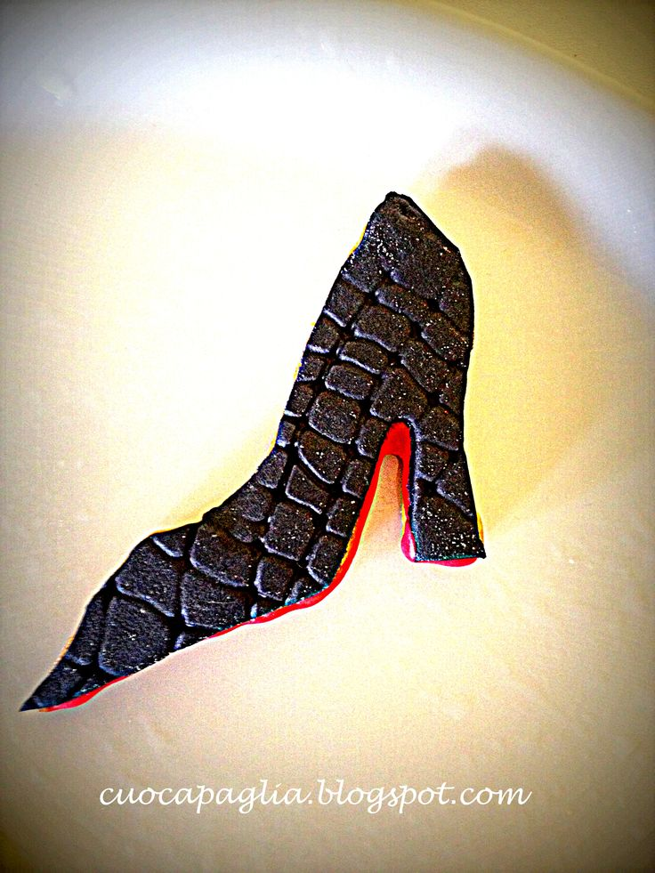 black Louboutin  reptile in pastry and sugar paste