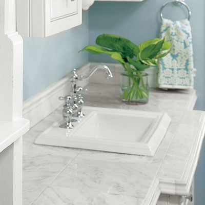 Use marble floor tiles, instead of a pricey slab, to create this counter. Curvy border tiles mimic an ogee edge. Lansdale Carrara 12-inch tiles, $9 per square foot; and Lansdale Carrara Barnes borders, $17 each