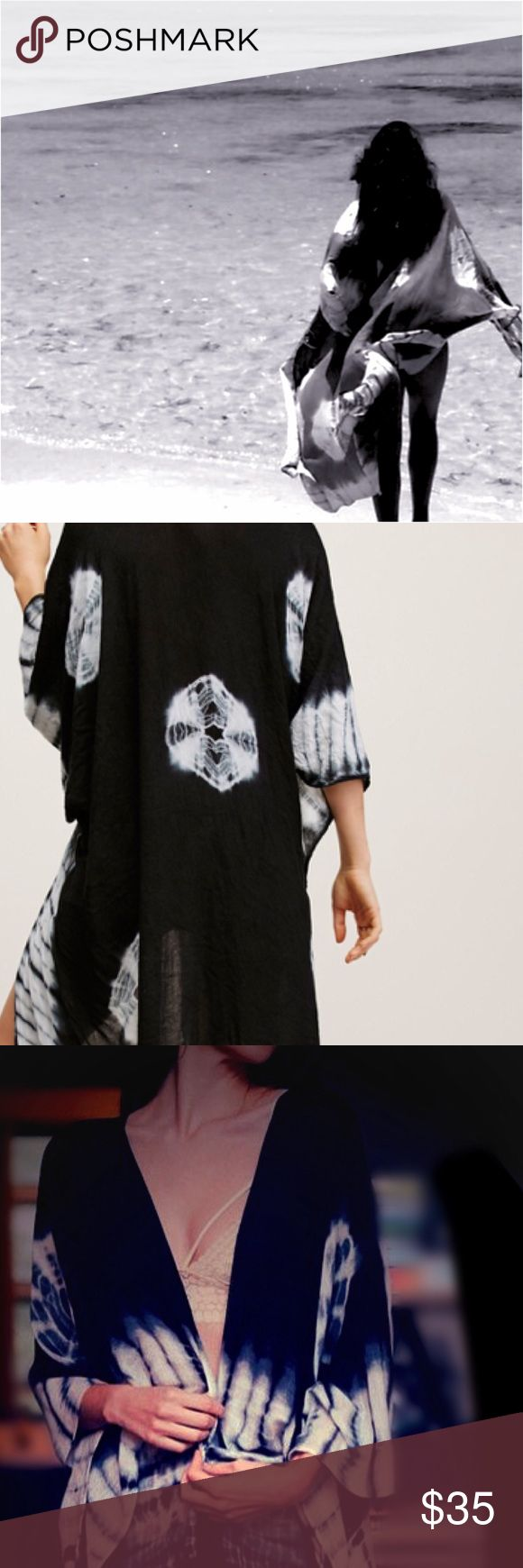 """Free People Tie Dye Kimono Free People Spellbound Tye Dye Black Kimono NEW   In a super soft fabric and tie dye pattern this maxi kimono features statement cutout detailing under the arms.   • 100% Viscose  • Dry Clean  • Import  • Measurements for size One Size  • Length: approx 57.0""""   • Sleeve Length: approx 28.0"""" Free People Other"""