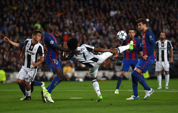 Juan Cuadrado of Juventus attempts to shoot during the UEFA Champions League Quarter Final second leg match between FC Barcelona and Juventus at Camp Nou on April 19, 2017 in Barcelona, Catalonia.