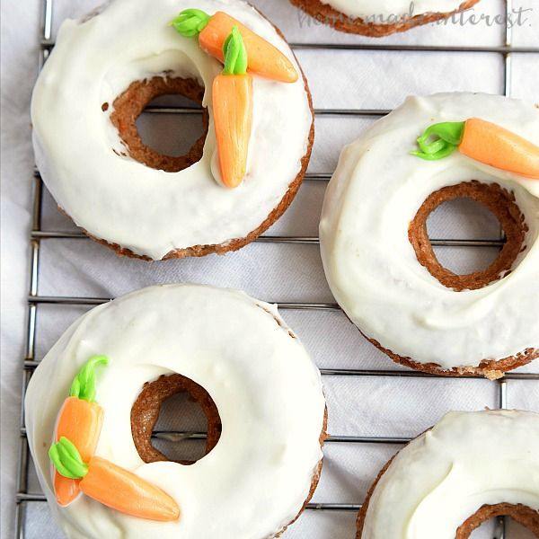 These baked Carrot Cake donuts are an easy Easter brunch recipe frosted with a cream cheese glaze and topped with edible carrots.