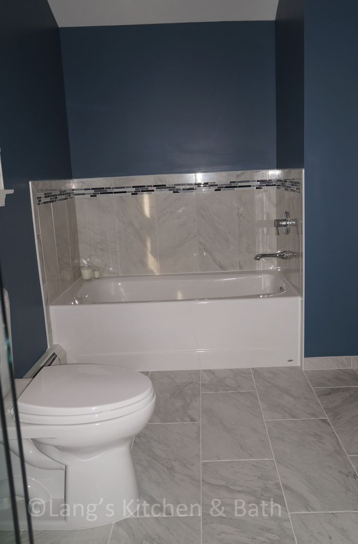 this style bathroom design beautifully contrasts a white fabuwood vanity cabinet and american standard tub dreamline shower