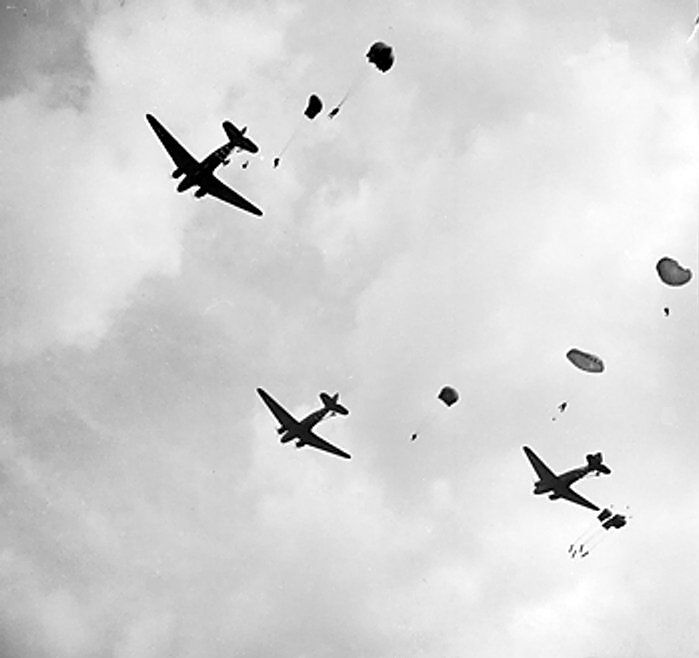 C-47 Dakota aircraft dropping troops of UK 1st Airborne Division over Oosterbeek near Arnhem, the Netherlands, 17 September 1944. (Imperial War Museum)