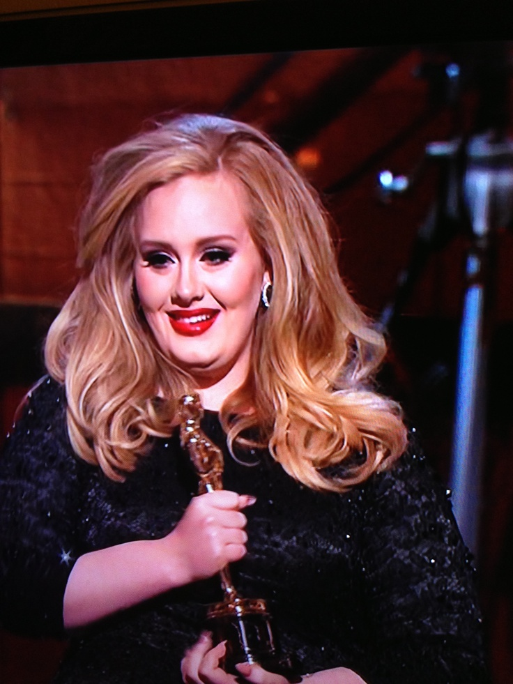 A very happy Adele winning the third award  for Skyfall song.