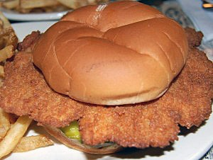 "Take a bite out of this famous Hoosier sandwch that's made with pork tenderloin and that also inspired filmmaker Jensen Rufe to create the documentary ""In Search of the Famous Hoosier Breaded Pork Tenderloin Sandwich,"" as part of his thesis at film school. Start out with 5-ounce cuts of pork to create this mouth-watering sandwich./Photo by Julia Bergman"