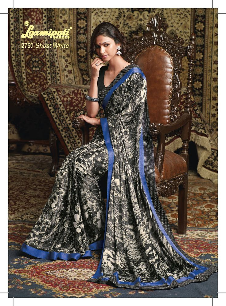 This gray & black saree with blue border crape material used