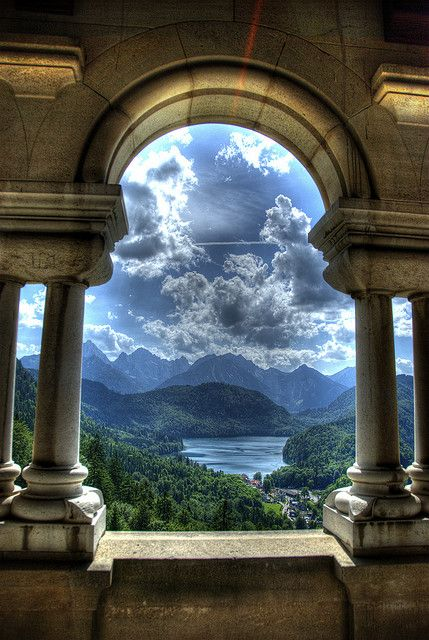 Neuschwanstein Castle  is a 19th-century Romanesque Revival palace on a rugged hill above the village of Hohenschwangau