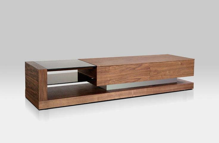 The Modrest Mali Walnut TV Stand features a rectangular top in Walnut Veneer Finish frame. Fitted with two 2-drawer nightstands, it features a black glass top with a 2-level open shelving. Strengthened by an aluminum support, it features electrical wire holes for better wire organization. With a dimension of W79