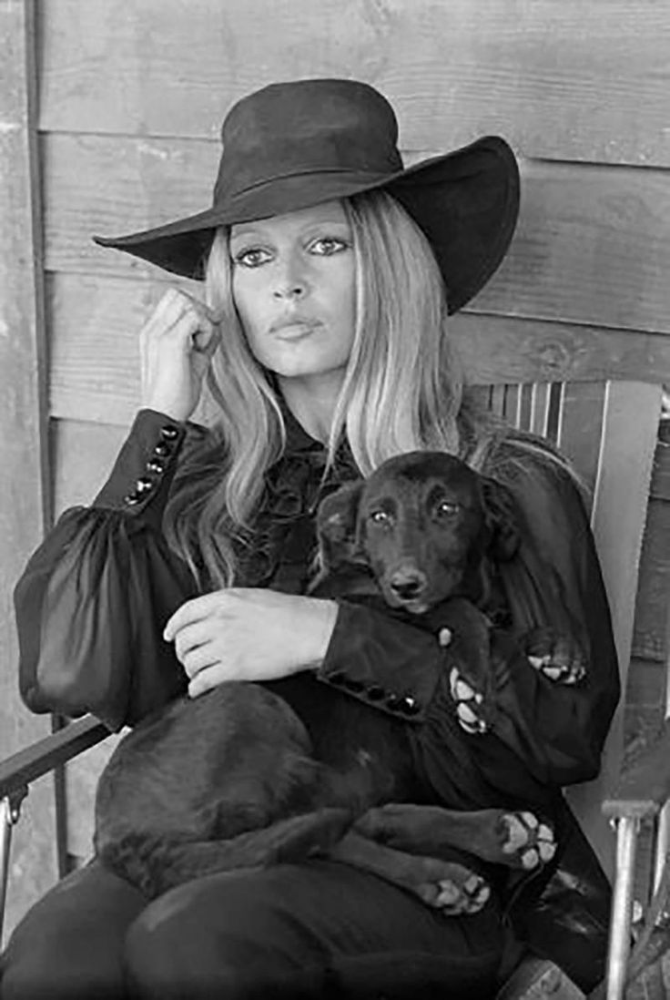 Brigitte Bardot With Puppy | From a unique collection of black and white photography at https://www.1stdibs.com/art/photography/black-white-photography/