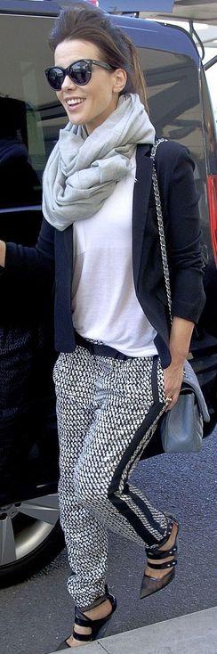 Kate Beckinsale: Sunglasses – Oliver Goldsmith  Purse – Chanel  Pants – Diane von Furstenberg
