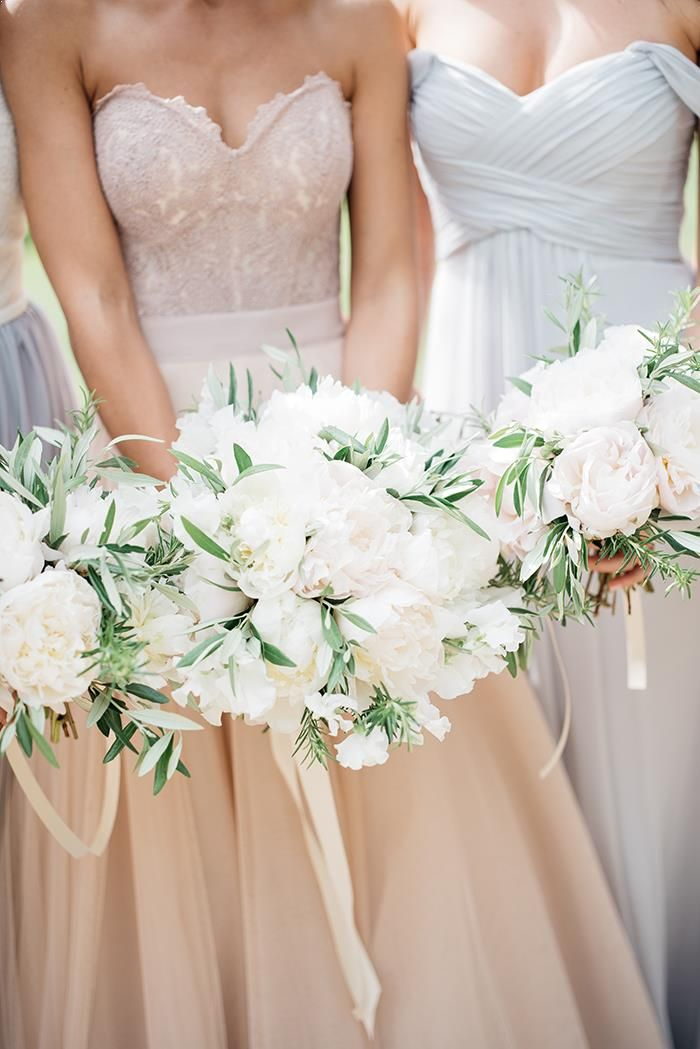 white with purply green folage to stand oout pastel dresses and pastel bouqet for white dress