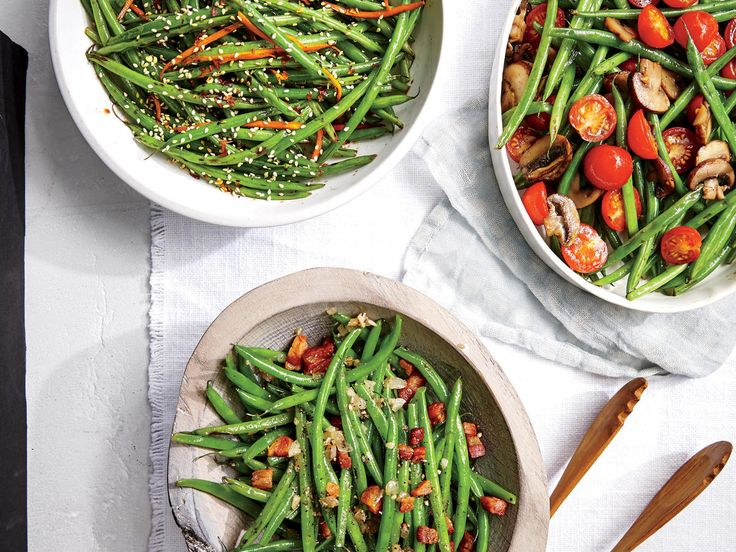 Haricots Verts with Carrots and Sesame | Slender haricots verts need little embellishment. Here they're tossed with a good dose of carrots and sesame seeds. Once it's cooked, the flavor mellows considerably. If you can't find the tiny French green beans, substitute regular green beans and increase the cook time in boiling water to five minutes to ensure they're done.