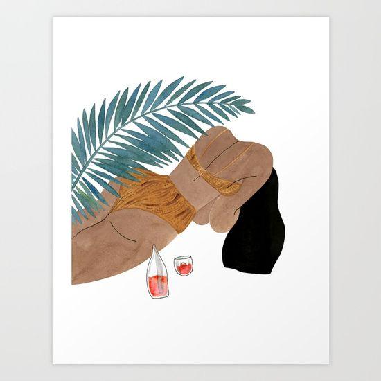 A gal wearing a Swimware bathing suit under a palm tree.