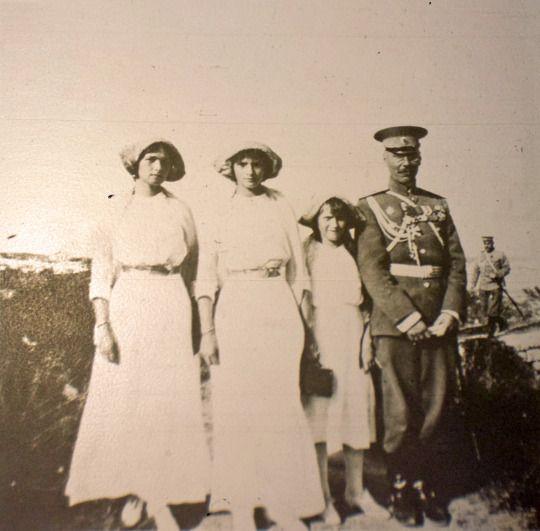 Olga, Tatiana and Anastasia with an officer on holiday, 1913