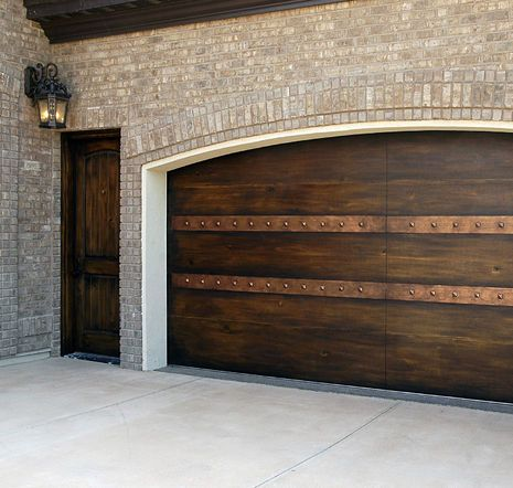 Faux painted garage door and fiber core man door to wood for Faux wood finish garage door