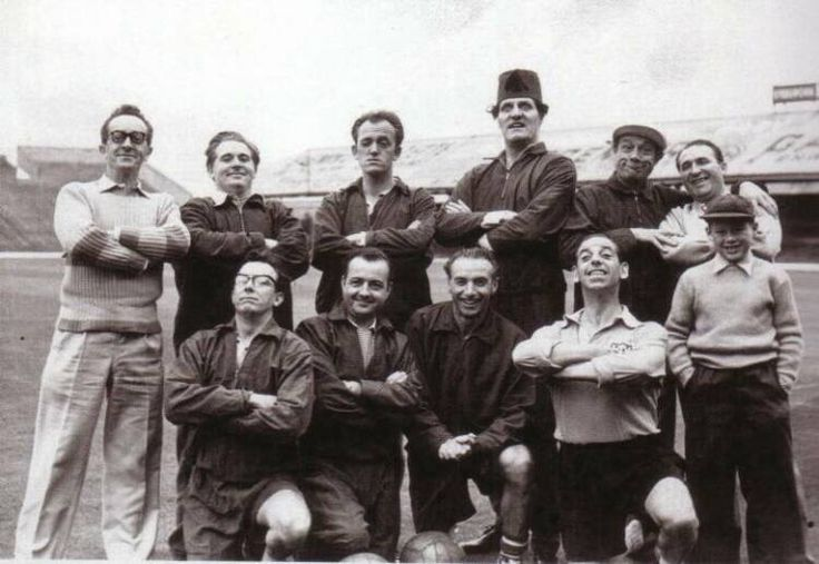 Tommy Cooper, Eric Morecambe, Ernie Wise, Jimmy Jewel, Stan Stennet(?), Jimmy Clitheroe(?), Charlie Chester(?) amongst others with Stanley Matthews at Bloomfield Road for a Comedians XI v Blackpool FC charity match in the 50s.