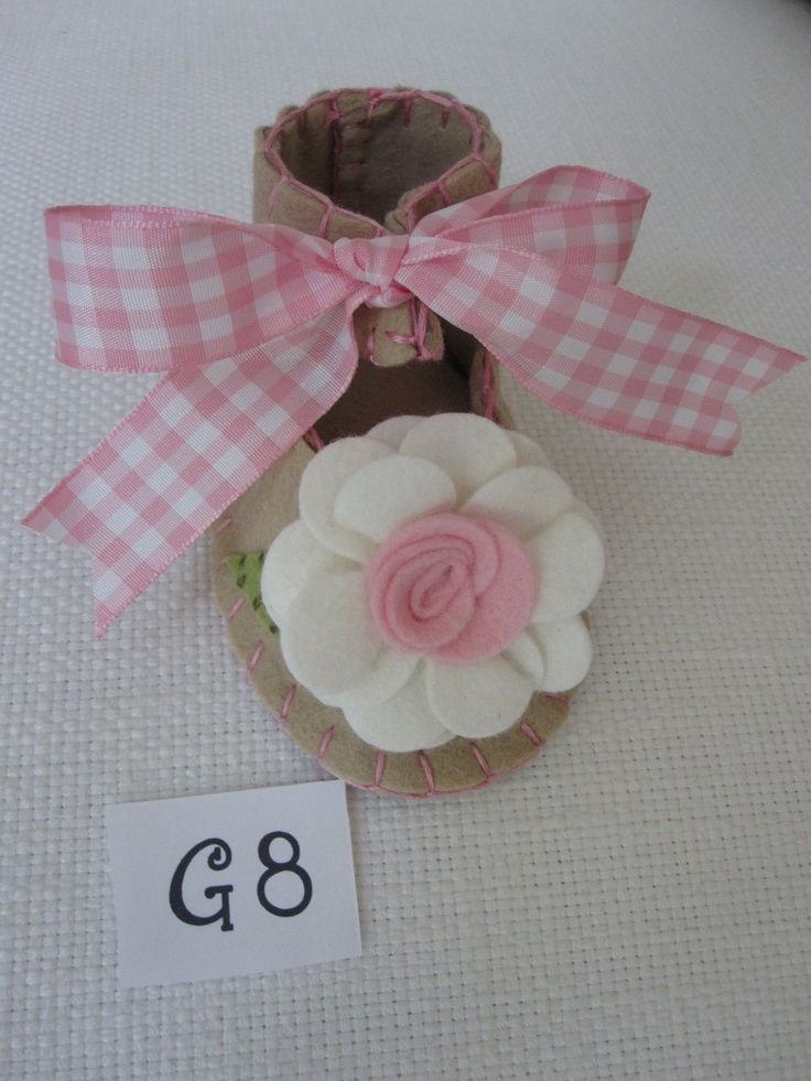Girl Baby Bootie in tan with pink and white flower. $20